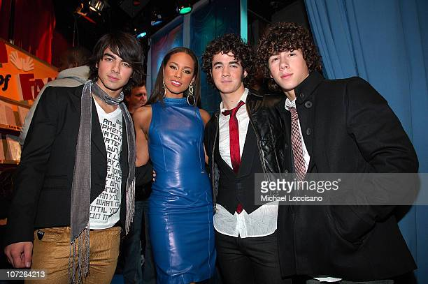 Musician Alicia Keys with musicians Joe Jonas Nick Jonas and Kevin Jonas of Jonas Brothers during MTV's Total Request Live at the MTV Times Square...