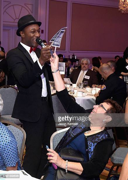 Musician Aloe Blacc and Executive Director Peace Over Violence Patricia Giggans perform during the Peace Over Violence 43rd annual Humanitarian...
