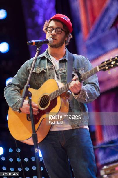 Musician Amos Lee performs onstage during the Farm Aid benefit concert at the Saratoga Performing Arts Center, Saratoga Springs, New York, September...