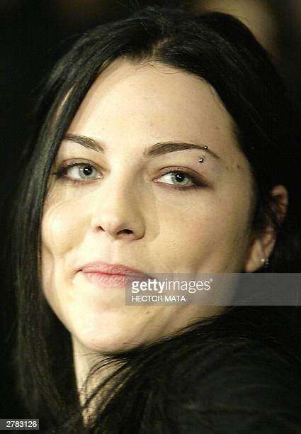 Musician Amy Lee lead singer of rock group Evanescence is interviewed by a TV crew during the 46th Annual Grammy Awards Nominations in Beverly Hills...