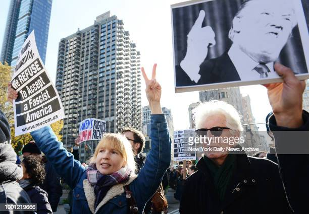 Musician and activist Graham Nash of Crosby Stills Nash and girlfriend Amy Grantham join march Thousands of protestors gather and march from Union...