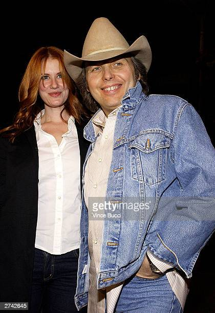 "Musician and actor Dwight Yoakam and Kristen Huff attend the premiere of ""Bad Santa"" at the Bruin Theater on November 18, 2003 in Los Angeles,..."