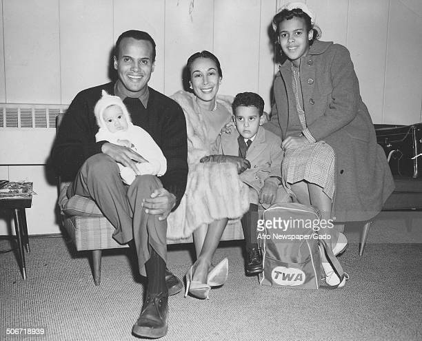 Musician and actor Harry Belafonte Adrienne Belafonte David Belafonte and Julie Belafonte boarding a TWA airplane January 13 1962