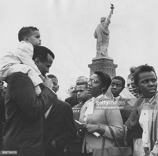 Musician and actor Harry Belafonte and David Belafonte talking with fans at Liberty Island during a concert, New York City, New York, May 19, 1960.