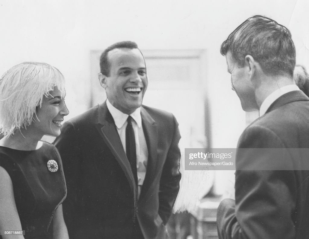 Musician and actor Harry Belafonte, Julie Belafonte and former Senator and Attorney General Robert Kennedy laughing, April 14, 1962.