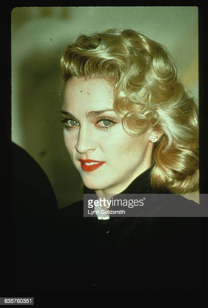 Musician and actress Madonna with a 1940s hairstyle.