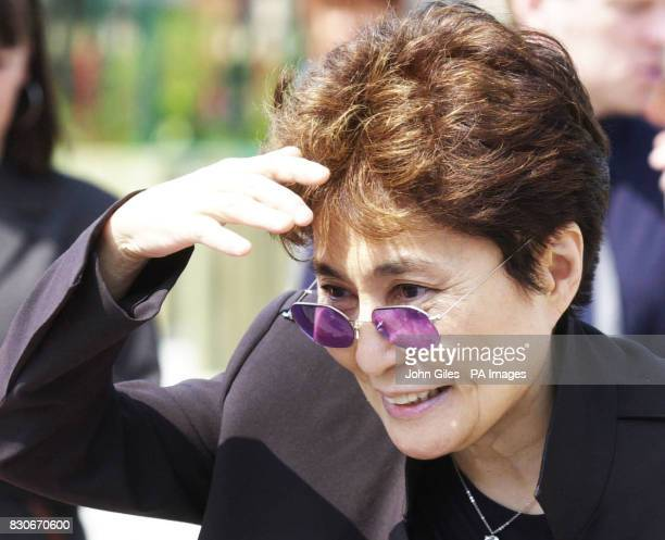 Musician and artist Yoko Ono widow of Beatles singer John Lennon watches children playing at Dovedale School in Liverpool She visited the school...