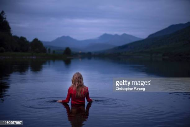 Musician and composer Hero Douglas poses as she records the sounds of nature in around Llyn Mymbyr in Snowdonia on July 09 2019 in Capel Curig Wales...