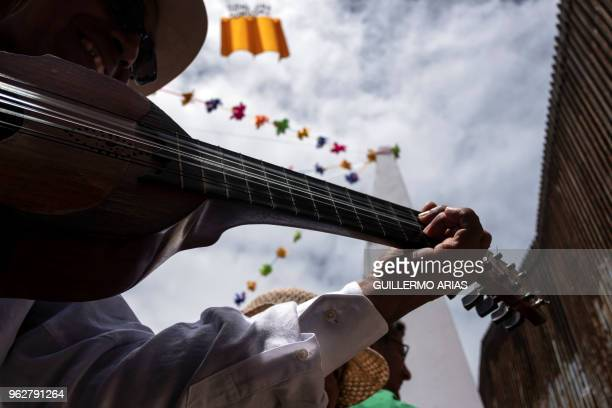 TOPSHOT A musician and dancer taking part in the annual Fandango Fronterizo event performs near the border fence at the Friendship Park on the...
