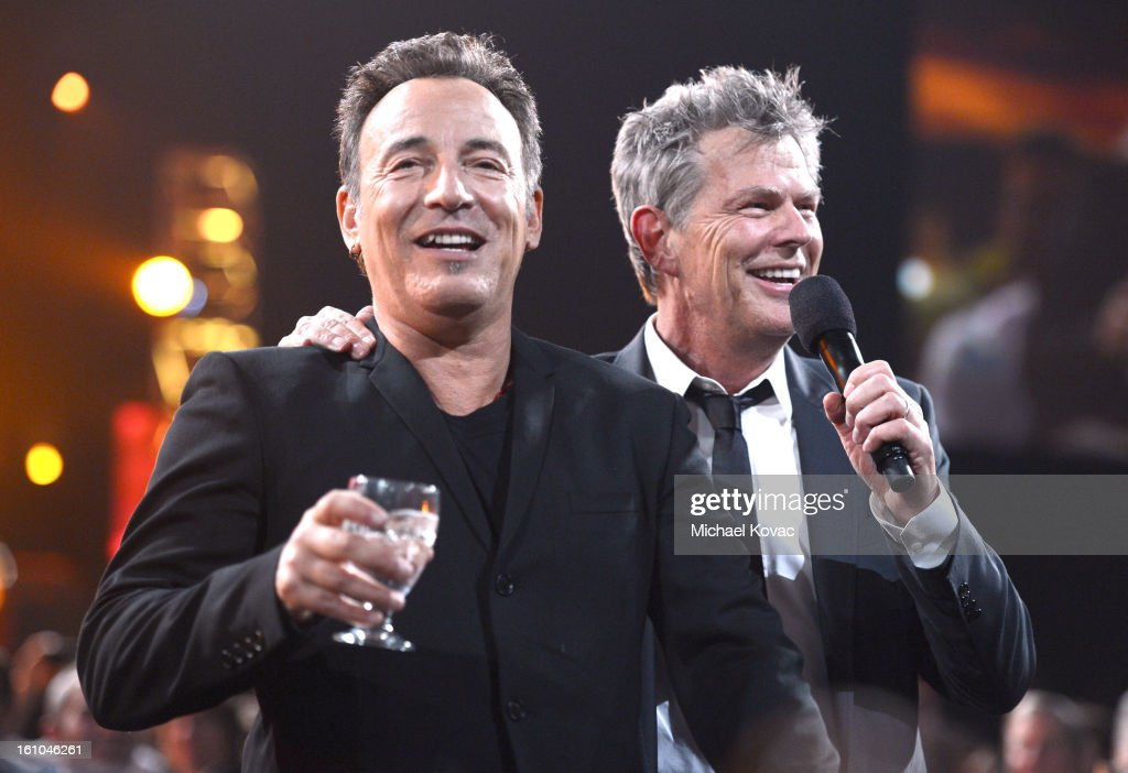 Musician and honoree Bruce Springsteen (L) participates in the auction with musician David Foster during MusiCares Person Of The Year Honoring Bruce Springsteen at the Los Angeles Convention Center on February 8, 2013 in Los Angeles, California.