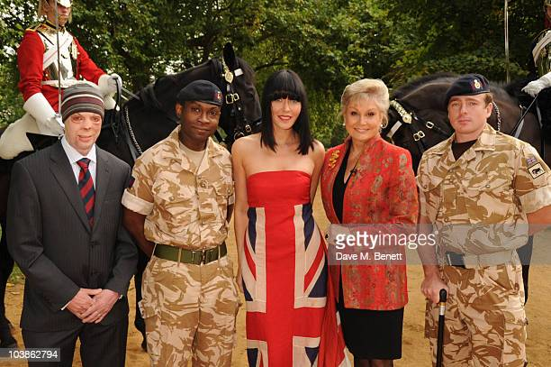 Musician and performer Linzi Stoppard poses with Trooper Clifford O'Farrell Trooper Corey Mapp Angela Rippon and LCpl Martyn Cromton with Household...