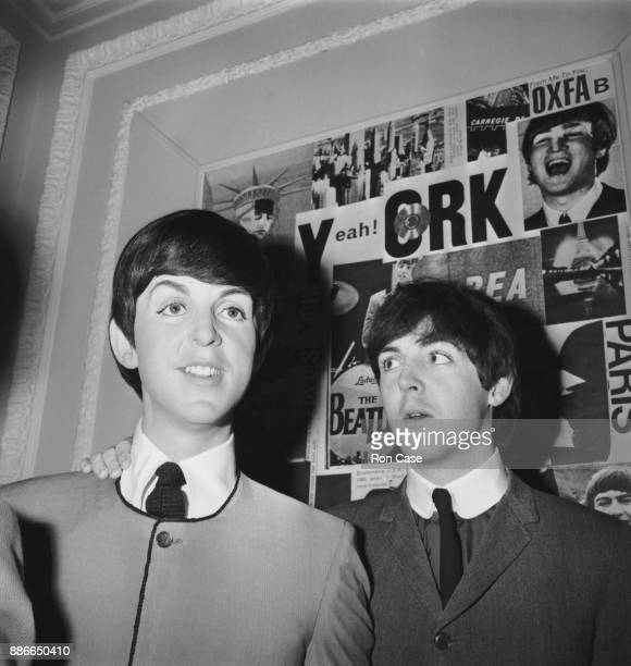 Musician and singer Paul McCartney of British rock group the Beatles poses with a waxwork effigy of himself at Madame Tussauds in London, 29th April...