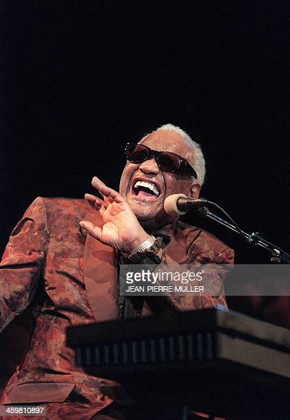US musician and singer Ray Charles performs 12 August 1997 during Marciac Jazz Festival Charles legendary musician dubbed the Genius of Soul during...