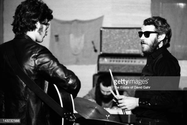 Musician and singer Robbie Robertson and musician and singer Levon Helm of the rock group The Band rehearse in December 1969 in Woodstock New York