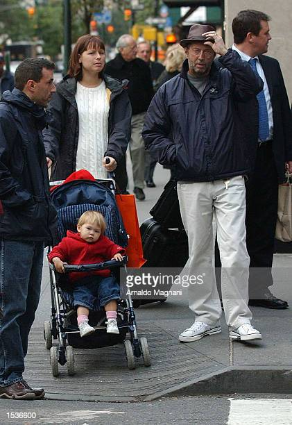Musician and song writer Eric Clapton walks with wife Melia McEnery and their baby Julie Rose Clapton while shopping on Madison Avenue October 28...