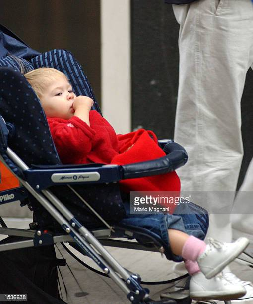 Musician and song writer Eric Clapton's daughter Julie Rose Clapton sits in her stroller as her dad and mother Melia McEnery walk with her on Madison...