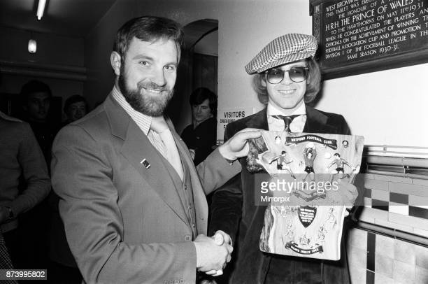 Musician and Watford FC chairman Elton John is presented with a special Jubilee plaque presented to him by West Bromwich Albion fan Ray Egan This was...
