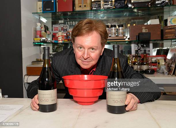 Musician and winemaker Gerald Casale of DEVO poses with bottles of his The 50 By 50 wine brand at a wine tasting at The Record Parlour on June 30...