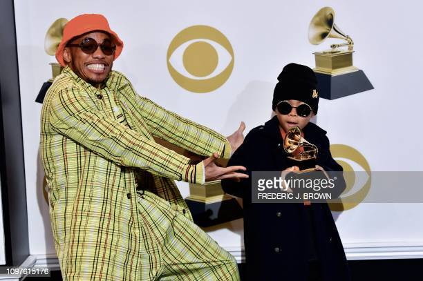 US musician Anderson Paak and his son Soul Rasheed poses with his award for best rap performance in the press room during the 61st Annual Grammy...