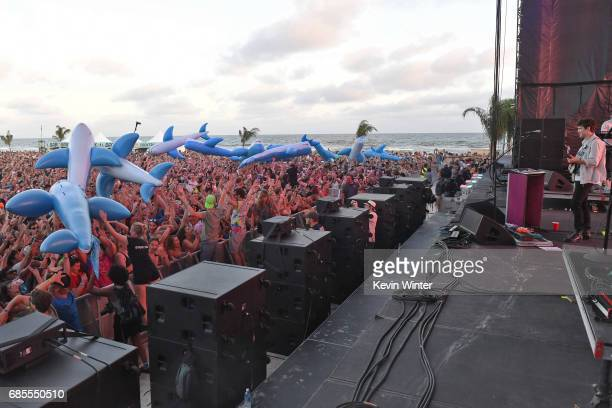 Musician Andrew VanWyngarden of MGMT performs at the Hangout Stage as Inflatable Whales crowd surf over festivalgoers during 2017 Hangout Music...