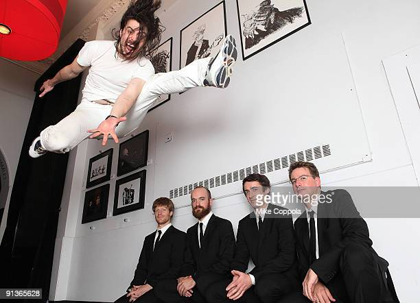 Musician Andrew WK jumps over the Calder Quartet at Joe's Pub on October 2 2009 in New York City