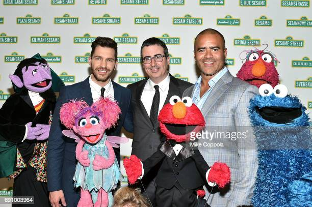 Musician Andy Grammar Comdian/Political Commentator John Oliver and Actor/singer Chris Jackson pose for a photo at the 15th Annual Sesame Workshop...