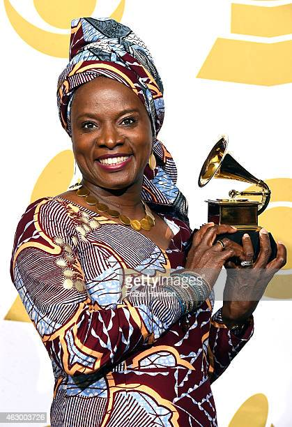 Musician Angelique Kidjo winner of the Best World Music Album Award for Eve poses in the press room during The 57th Annual GRAMMY Awards at the...