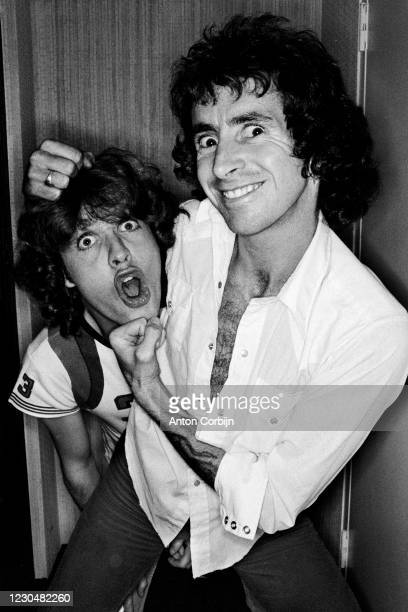 Musician Angus Young and Bon Scott from AC/DC music band, poses for a portrait, in 1978.