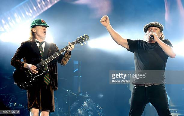 Musician Angus Young and singer Brian Johnson of AC/DC perform at Dodger Stadium on September 28 2015 in Los Angeles California