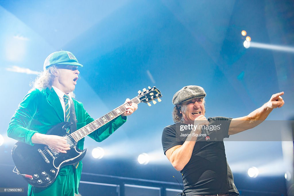 Musician Angus Young (L) and singer Brian Johnson of AC/DC performs at Sprint Center on February 28, 2016 in Kansas City, Missouri.