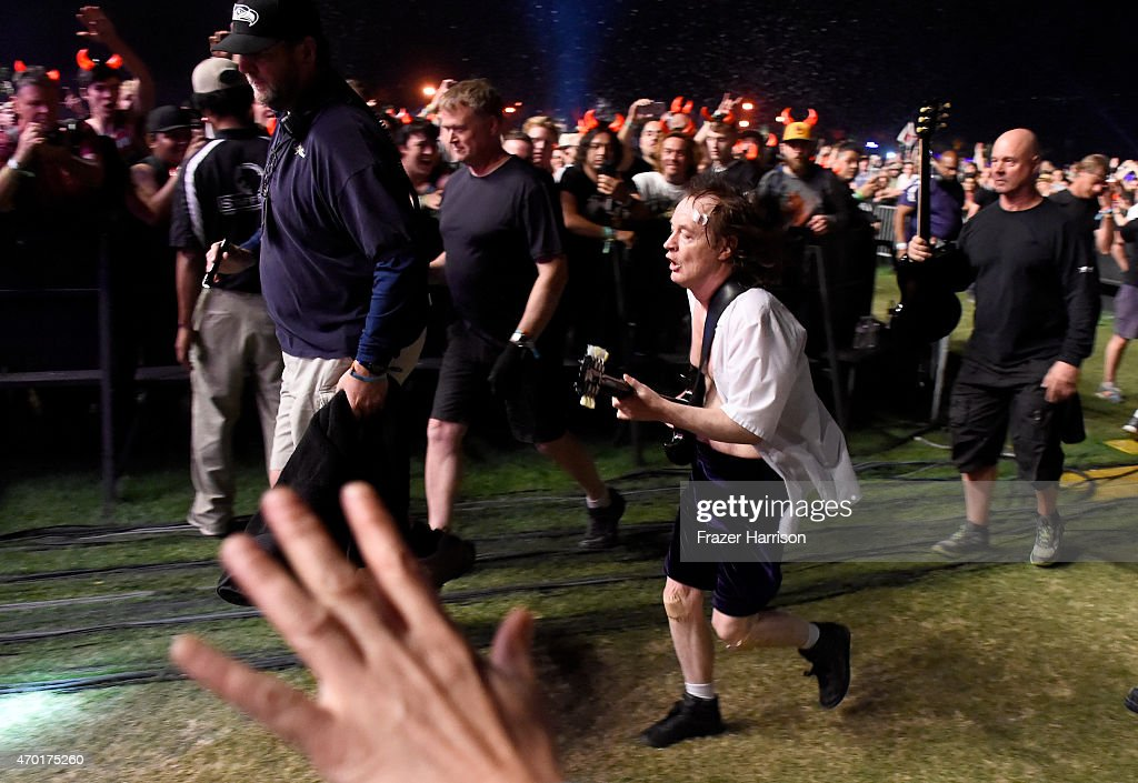 Musician Angus Young of AC/DC performs in the crowd during day 1 of the 2015 Coachella Valley Music And Arts Festival (Weekend 2) at The Empire Polo Club on April 17, 2015 in Indio, California.