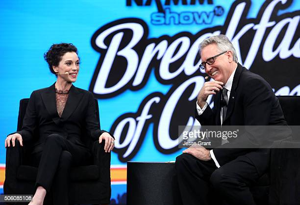 Musician Annie Clark aka St Vincent and NAMM President and CEO Joe Lamond speak on stage at the 2016 NAMM Show Opening Day at the Hilton Anaheim on...