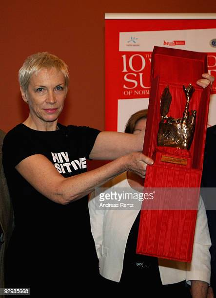 Musician Annie Lennox holds up the Peace award on the second day of the 10th World Summit of Nobel Peace Laureates at Berlin town hall on November 11...