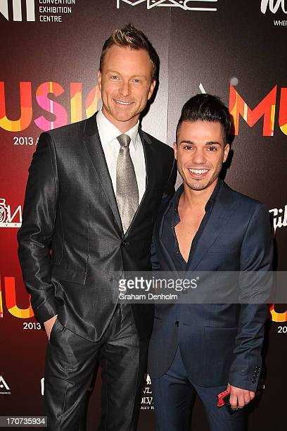 Musician Anthony Callea and partner Tim Campbell pose as they arrive at the 2013 APRA Music Awards at The Plenary on June 17 2013 in Melbourne...