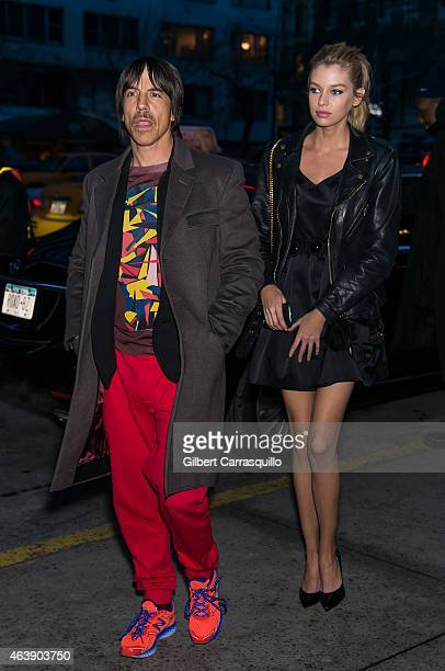 Musician Anthony Kiedis and guest are seen arriving at Marc Jacobs fashion show during MercedesBenz Fashion Week Fall 2015 at Park Avenue Armory on...