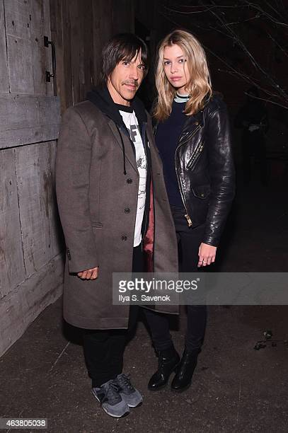 Musician Anthony Kiedis and guest attend the Greg Lauren fashion show during MercedesBenz Fashion Week Fall 2015 at ArtBeam on February 18 2015 in...