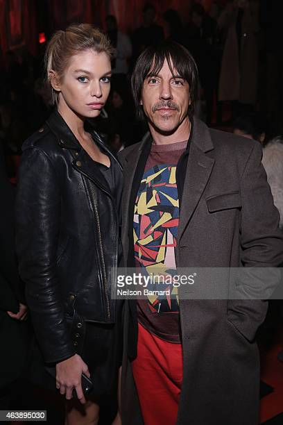 Musician Anthony Kiedis and guest attend the Marc Jacobs fashion show during MercedesBenz Fashion Week Fall 2015 at Park Avenue Armory on February 19...