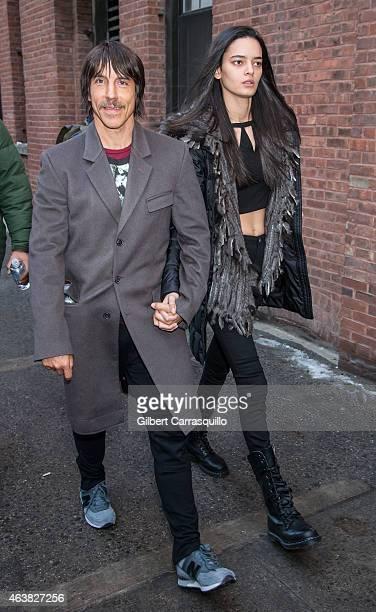 Musician Anthony Kiedis and Wanessa Milhomem are seen leaving Jeremy Scott fashion show during MercedesBenz Fashion Week Fall 2015 at Milk Studios on...