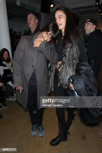 Musician Anthony Kiedis and Wanessa Milhomem attends the Jeremy Scott fashion show at Milk Studios during MADE Fashion Week Fall 2015 on February 18...