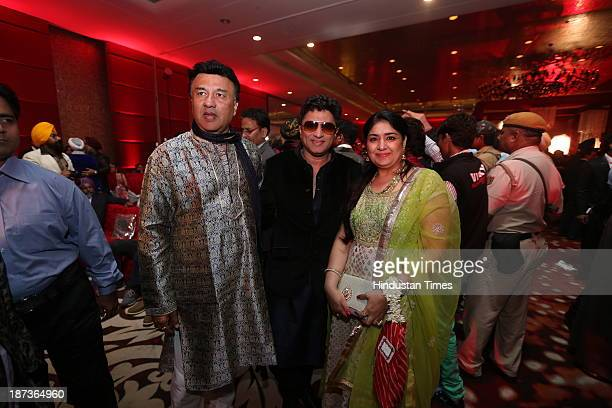 Musician Anu Malik with composer Anand Raj Anand and his wife during prewedding party of singer Daler Mehndi's daughter Ajit Kaur with Navraj Singh...