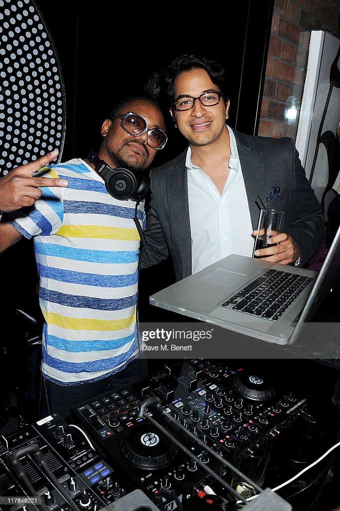 Musician Apl.de.Ap of the Black Eyed Peas (L) and Omar Amanat pose as Apl.de.Ap performs in the Night Lounge at Morton's Club on June 30, 2011 in London, England.