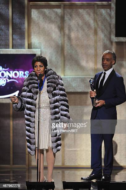 Musician Aretha Franklin and Reverend Al Sharpton appear onstage at BET Honors 2014 at Warner Theatre on February 8 2014 in Washington DC