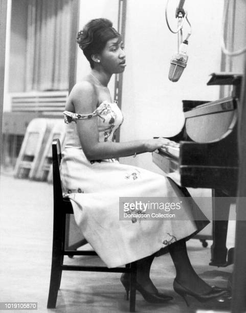 Musician Aretha Franklin recording at the piano at Columbia Studios in 1962 in New York