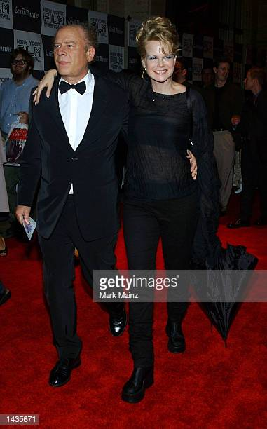 Musician Art Garfunkel and wife Kim Cermank arrive for the premiere of About Schmidt at the Lincoln Center on the opening night of the 40th New York...