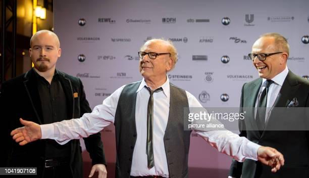 Musician Art Garfunkel his son James Garfunkel and Stefan SchulzeHausmann initiator of the Deutscher Nachhaltigkeitspreis pictured on the red carpet...