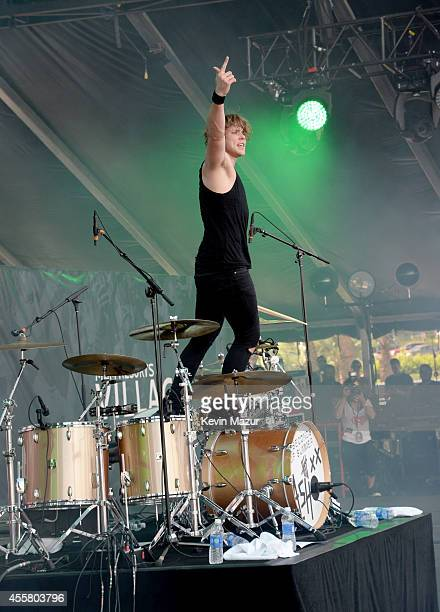 Musician Ashton Irwin of 5 Seconds of Summer performs onstage during the 2014 iHeartRadio Music Festival Village on September 20, 2014 in Las Vegas,...