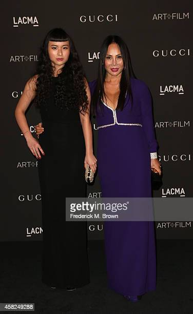 Musician Asia Chow and LACMA trustee Eva Chow attend the 2014 LACMA Art Film Gala honoring Barbara Kruger and Quentin Tarantino at LACMA on November...