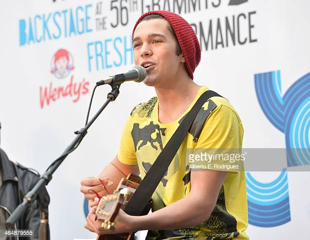 Musician Austin Mahone performs backstage at the GRAMMYs Westwood One Radio Remotes during the 56th GRAMMY Awards at the Staples Center Arena Club on...