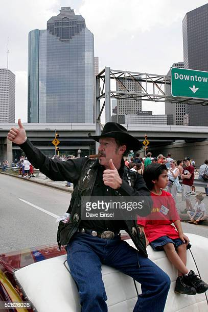 Musician author and Texas gubernatorial hopeful Kinky Friedman waves to the crowd during the Everyone's Art Car Parade May 14 2005 in Houston Texas...