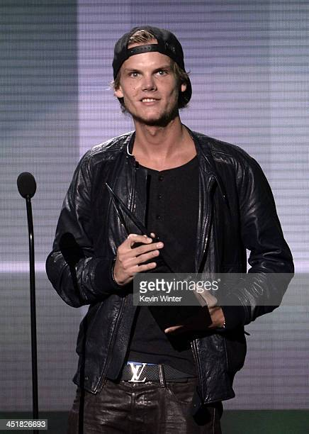 Musician Avicii accepts the Favorite Electronic Dance Music Artist award onstage during the 2013 American Music Awards at Nokia Theatre LA Live on...